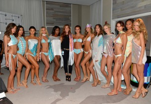 MIAMI BEACH, FL - JULY 18: Designer Kirsten Sarkisian (center) and models pose backstage at the Belusso 2016 Collection during SWIMMIAMI at 1 Hotel South Beach Salon on July 18, 2015 in Miami Beach, Florida. (Photo by Zoltan LeClerc/Getty Images for Belusso)