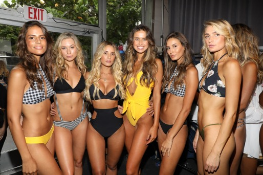 MIAMI, FL - JULY 21: Models prepare backstage during the SWIMMIAMI Prey Swim by Audrina Patridge Resort 2018 Collection fashion show at The Tent on July 21, 2017 in Miami, Florida. (Photo by Alexander Tamargo/Getty Images for Prey Swim By Audrina Patridge)
