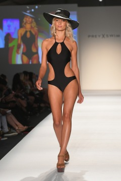 MIAMI, FL - JULY 21: A model walks the runway during the SWIMMIAMI Prey Swim by Audrina Patridge Resort 2018 Collection fashion show at The Tent on July 21, 2017 in Miami, Florida. (Photo by Rodrigo Varela/Getty Images for Prey Swim By Audrina Patridge)